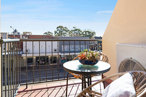 The Balcony of a One Bedroom Apartment with Spa at the Boulevard Apartments.