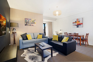 The Living Room of a One Bedroom Apartment with Spa at the Boulevard Apartments.