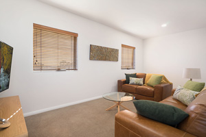 The Living Room of the Three Bedroom Apartment at Boulevard Apartments.