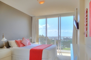 The Main Bedroom at The York Two Bedroom Oceanview Apartment at Newcastle Beach.