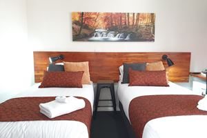 The Twin Share Room with twin share single beds.