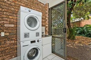 The Laundry of Centennial Terrace Apartments Superior 2 Bedroom Unit.