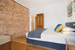 The main bedroom at 9 Alfred Street Terrace