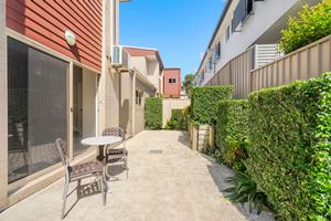 The Private Courtyard of a 2 Bedroom Townhouse Apartment at Birmingham Gardens Townhouses.