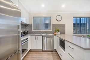 The Kitchen of a 3 Bedroom Townhouse Apartment at Birmingham Gardens Townhouses.
