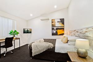 The Master Bedroom of a 3 Bedroom Townhouse Apartment at Birmingham Gardens Townhouses.