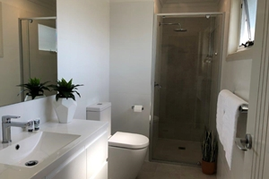 The Ensuite Bathroom of a 3 Bedroom Townhouse Apartment at Adamstown Townhouses.