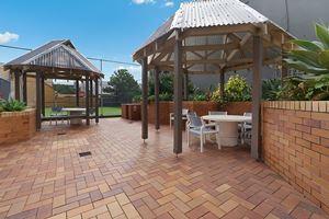 Sandbar Apartment provides an outdoor BBQ area.