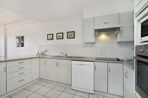 The Kitchen at Sandbar Apartment.