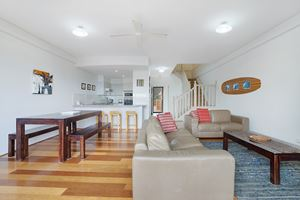 Sandbar Apartment provides a spacious living area on the ground floor.