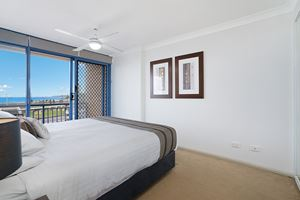 The Main Bedroom of Sandbar Apartment provides ocean views over Newcastle Beach.