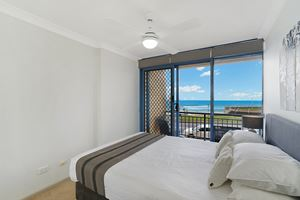 The Second Bedroom of Sandbar Apartment provides ocean views over Newcastle Beach.